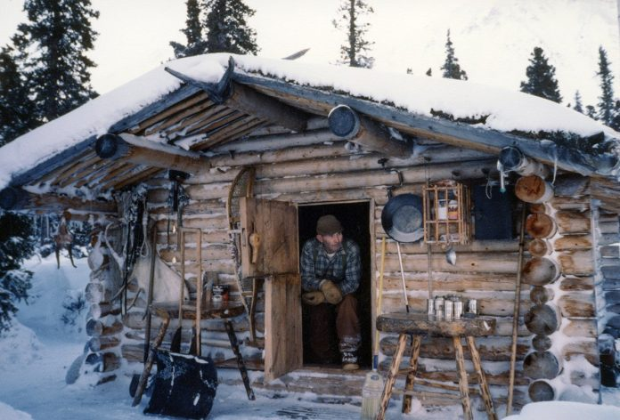 Dick Proenneke at his cabin in 1985. NPS photo taken by Richard Proenneke and donated by Raymond Proenneke